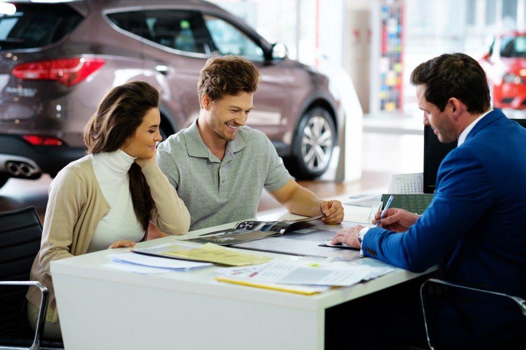Man signing paper at a car rental