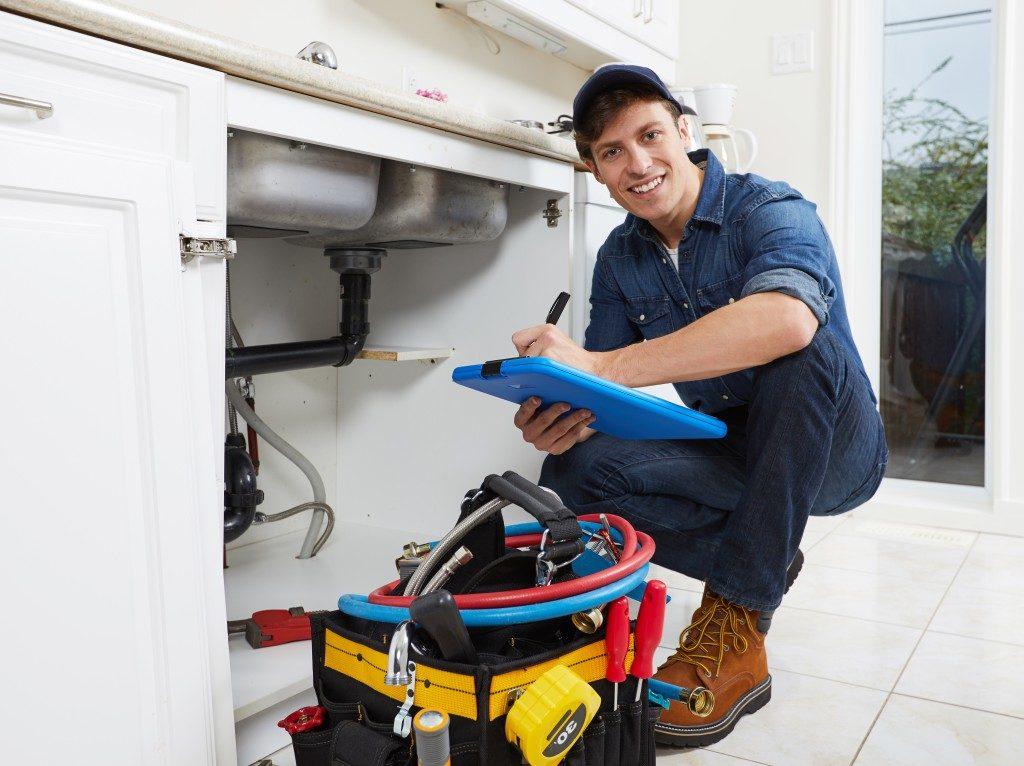 plumber checking