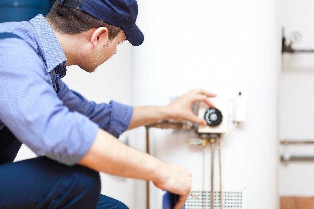 plumber fixing water pressure