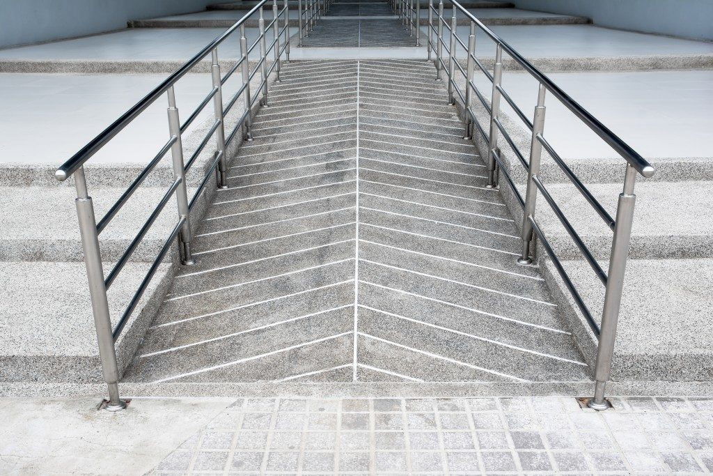 ramp for the wheelchair and stairs for people adjoining