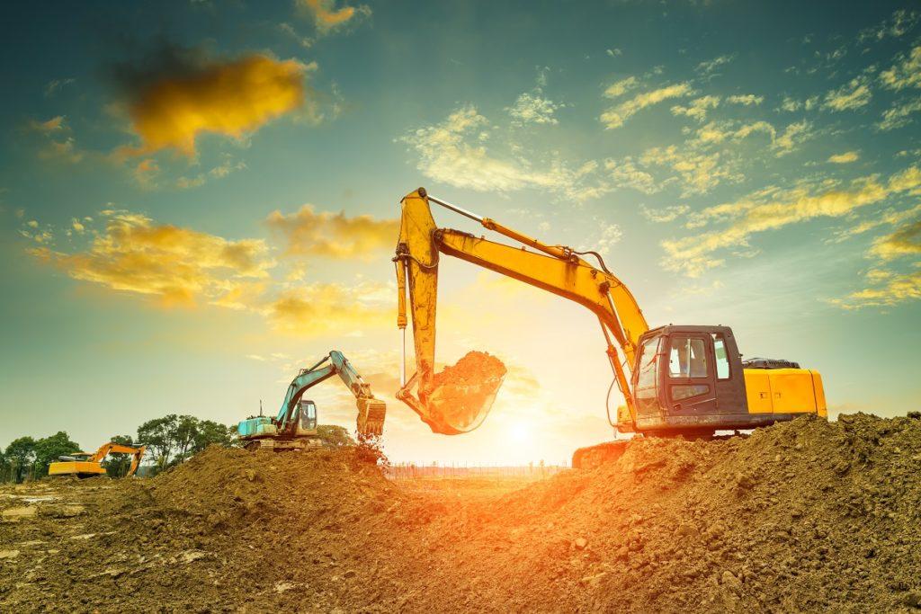 Excavators during sunset