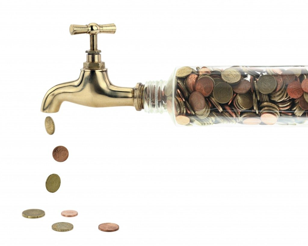 coins coming out of a faucet