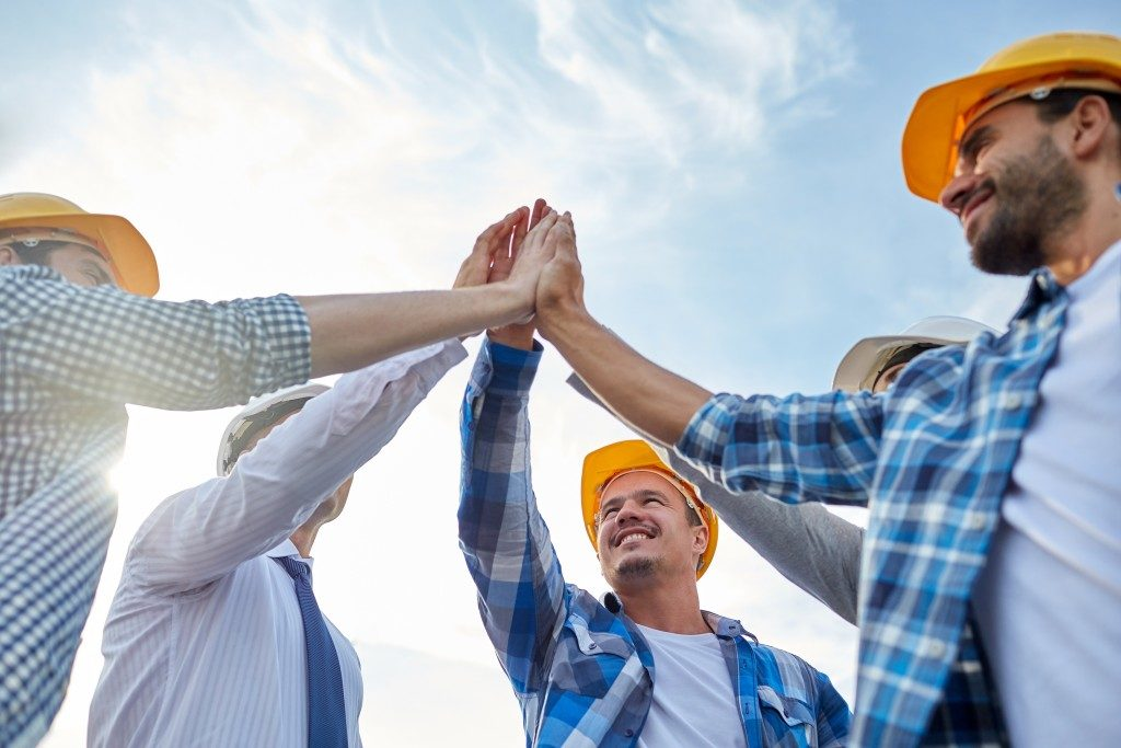 group of contractor giving each other a high-five