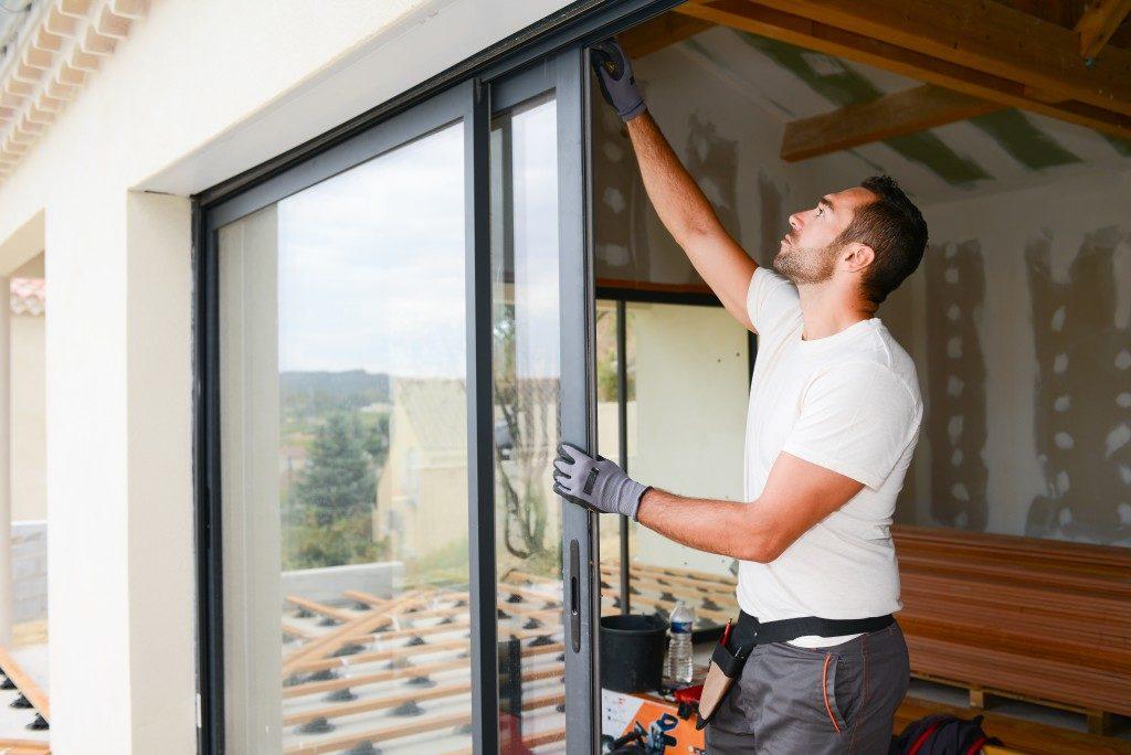 man installing a window