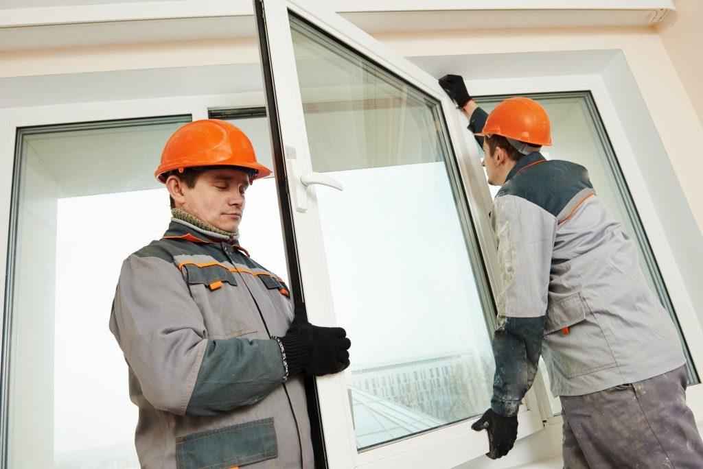 workers replacing windows