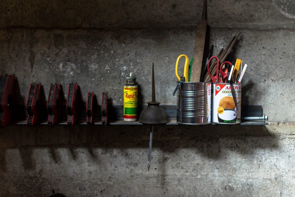 tools in a wall shelf of garage