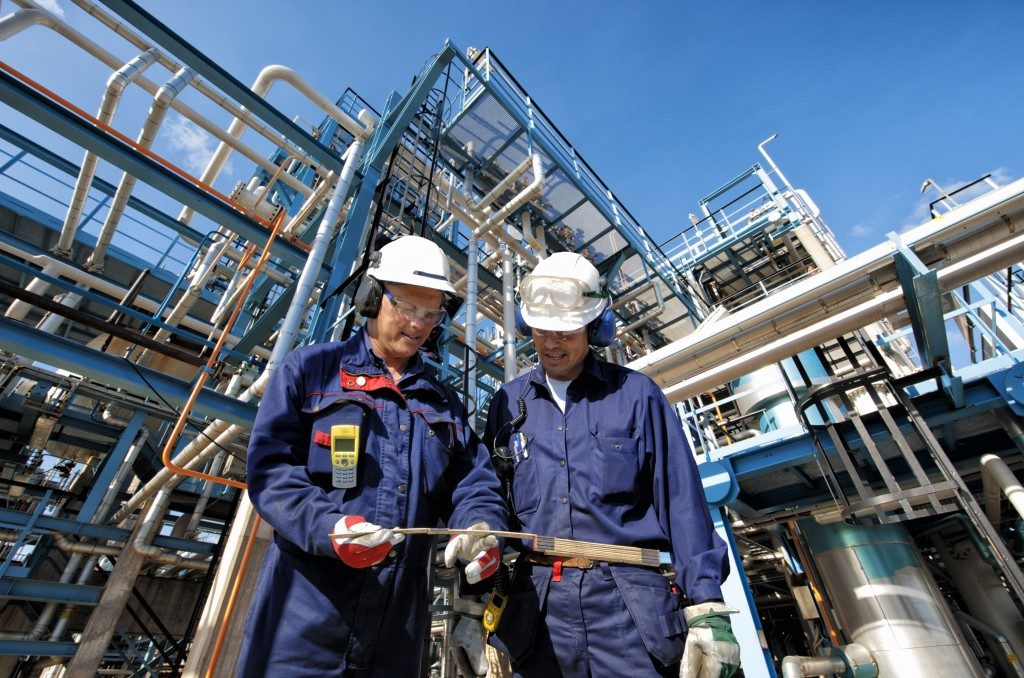 two workers in an oil industry