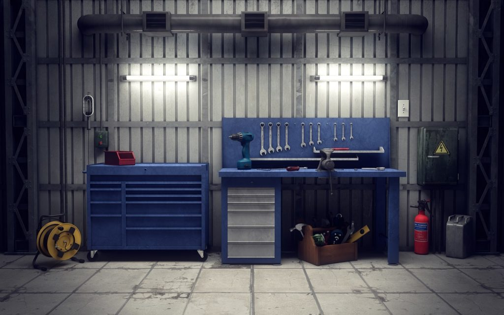 garage space with blue cabinets and tools
