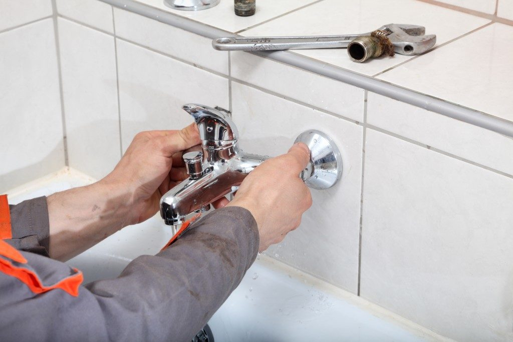 plumber installing a tap