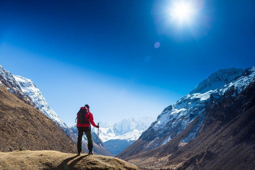 man hiking the mountains