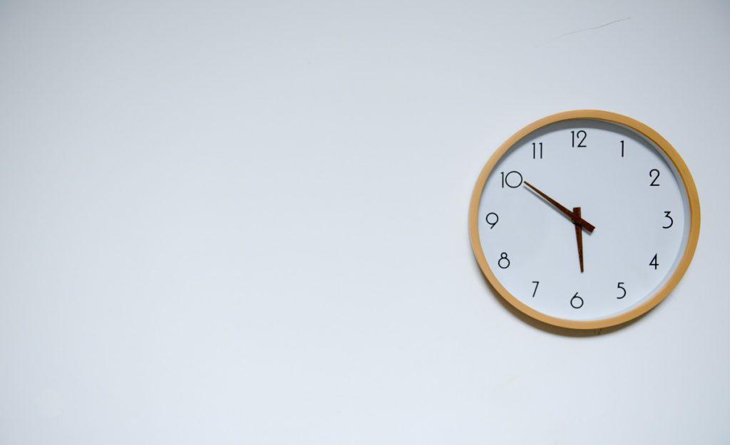 wall clock in a blanl background