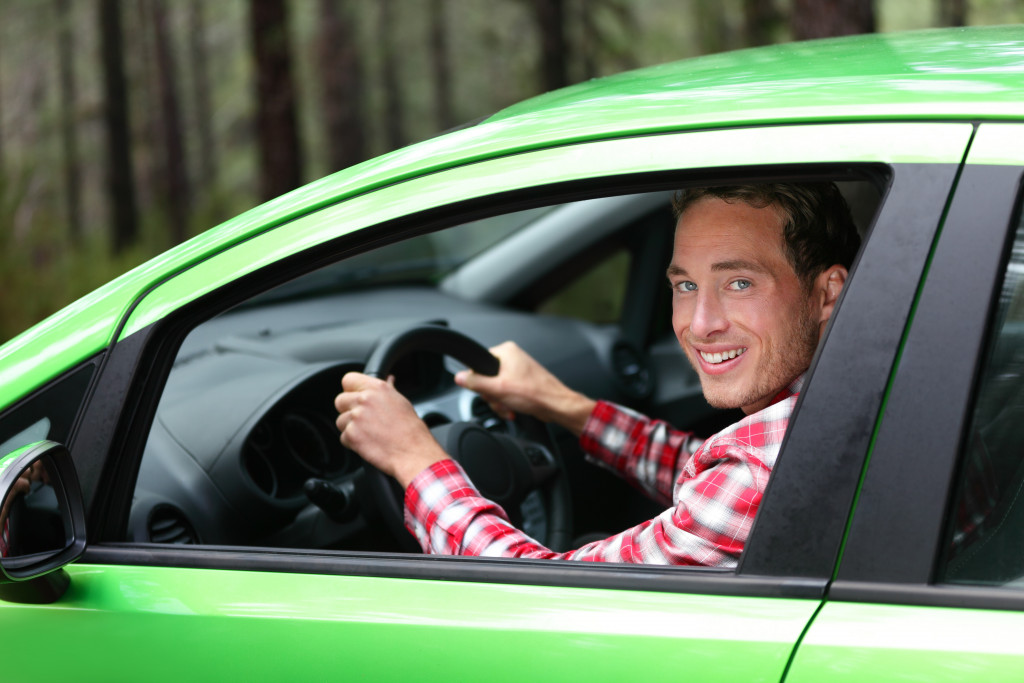 Man inside a green car