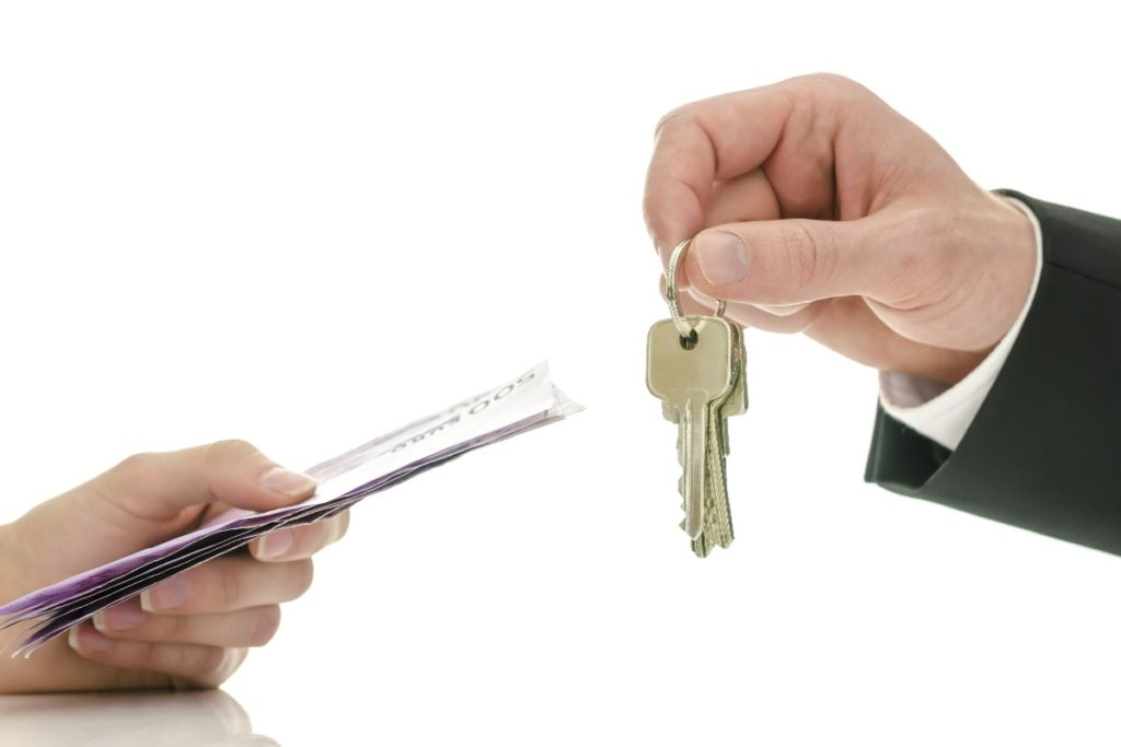 dollar bills and house keys