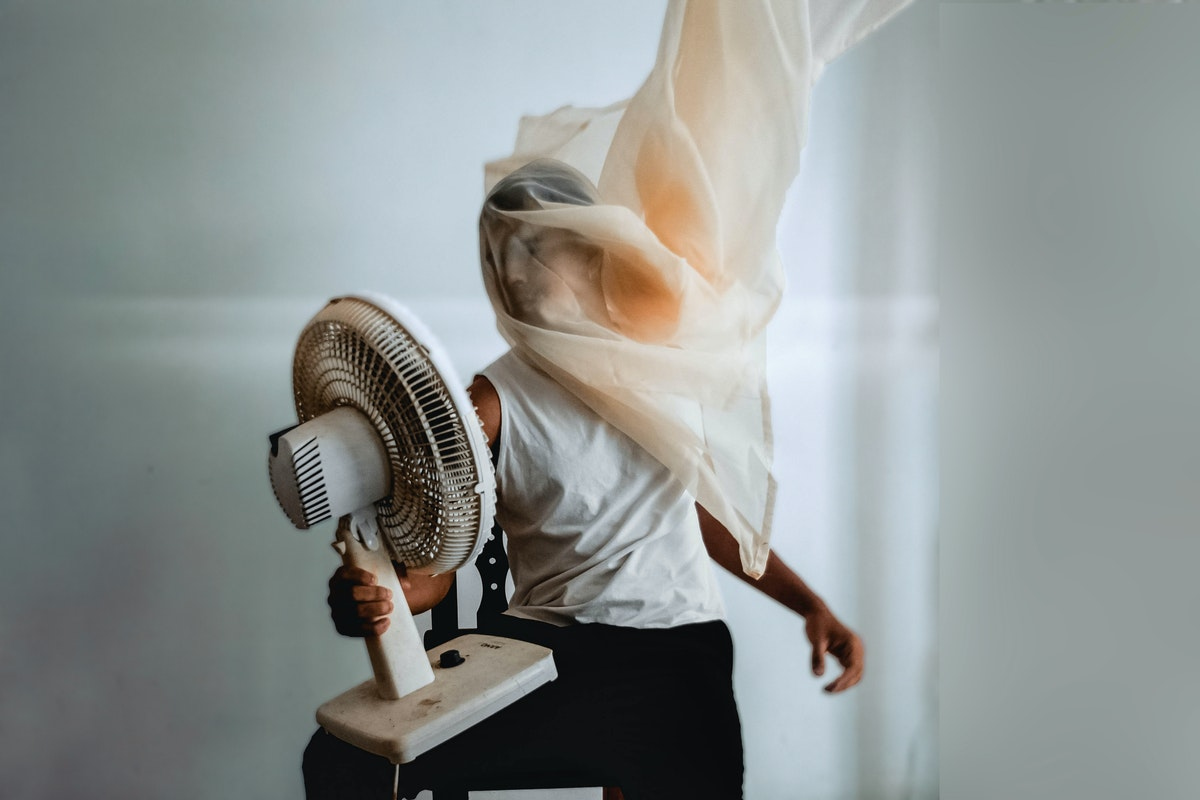 person holding a fan