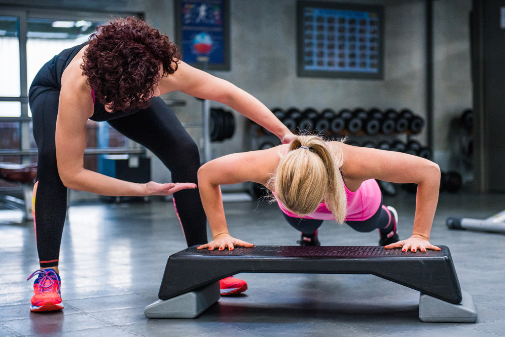 woman with fitness instructor